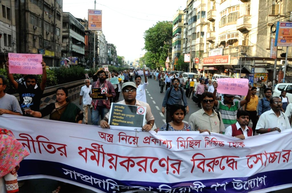 People participate in a rally to press for peace in West Bengal, in Kolkata on April 3, 2018.