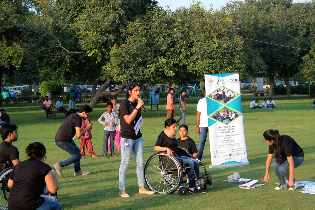 People participate in a rally to spread awareness on Spinal cord injuries on the occasion of 'World Spinal Cord Injury Day' at Rajpath in New Delhi on Sept 10, 2017. Over 100 Wheelchair ...