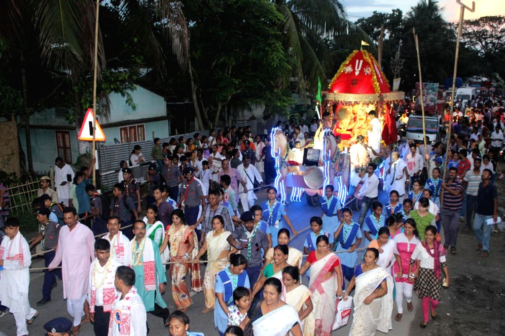 People participate in a Rath Yatra at Hajo in Kamrup district of Assam on July 6, 2016.
