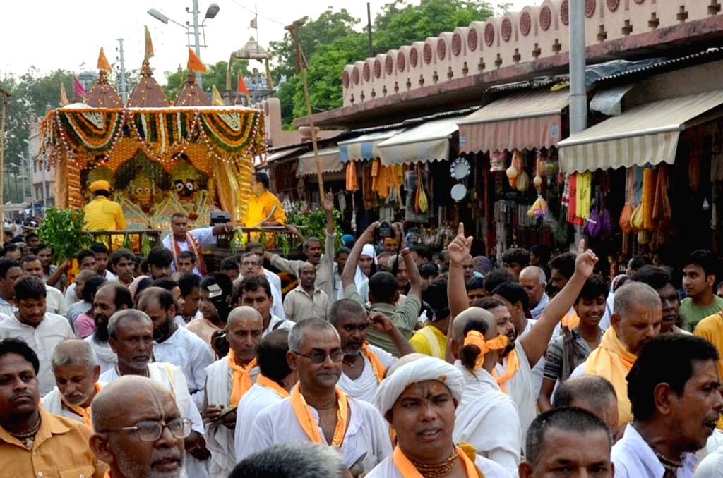 People participate in a Rath Yatra that started from the birth place of lord Krishna in Mathura on July 6, 2016.