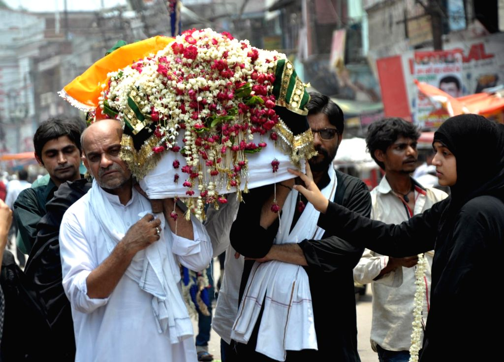 People participate in a religious procession organised on martyrdom day of Hazrat Ali in Allahabad, on June 27, 2016.