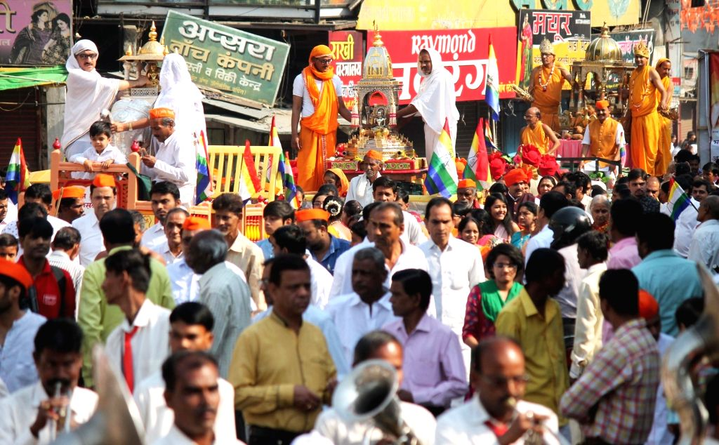 People participate in a religious procession organised on Mahavir Jayanti, in Nagpur on March 29, 2018.