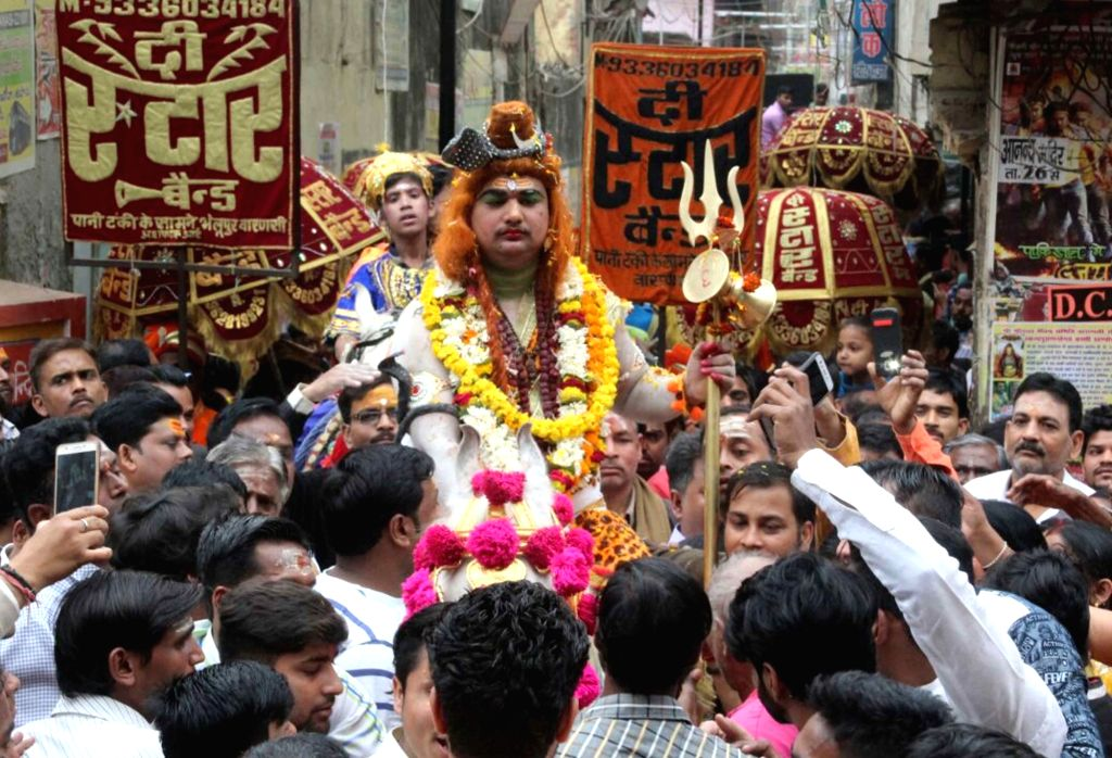 People participate in a religious procession on the occasion of Maha Shivaratri in Varanasi on Feb 13, 2018.