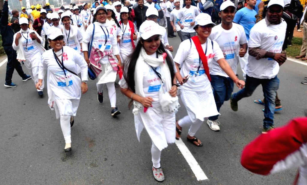 People participate in a run organised on the occasion of World AIDS Day in Patna on Dec 1, 2018.