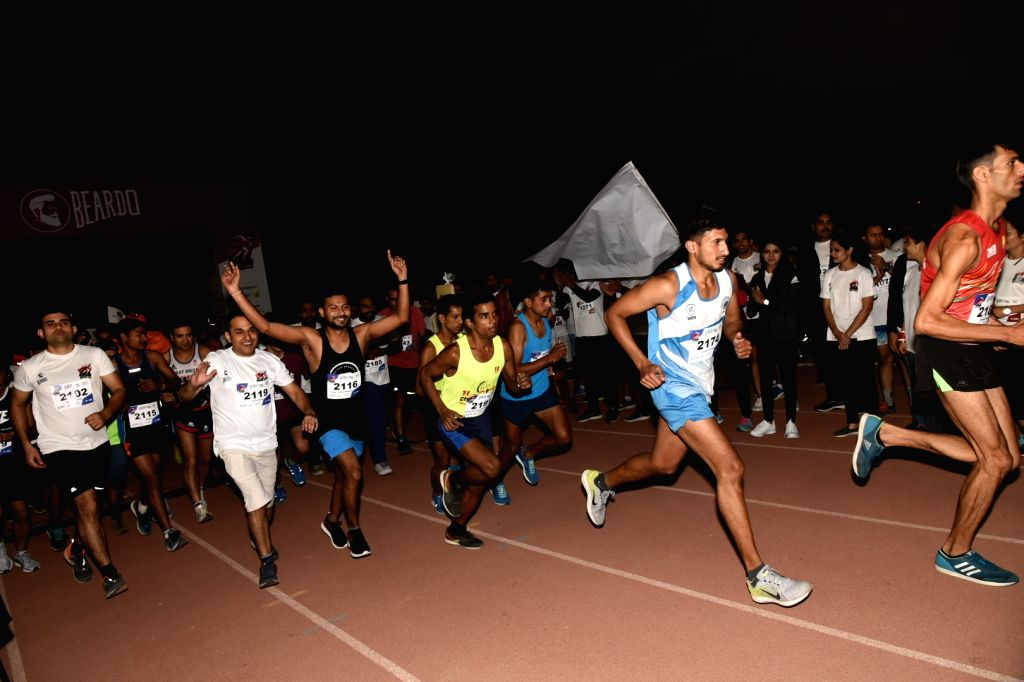 People participate in a run organised to spread awareness regarding men's health, at CWG village sports complex in New Delhi, on Nov 4, 2018.