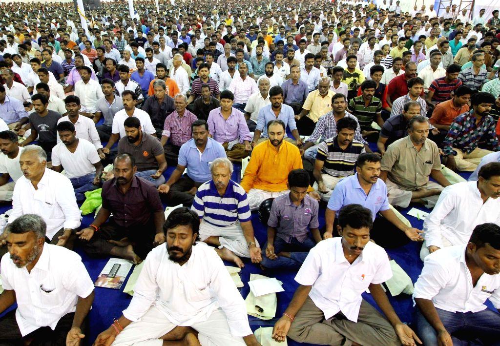 People participate in a yoga camp organised by Sadhguru Jaggi Vasudev in Chennai on June 5, 2016.