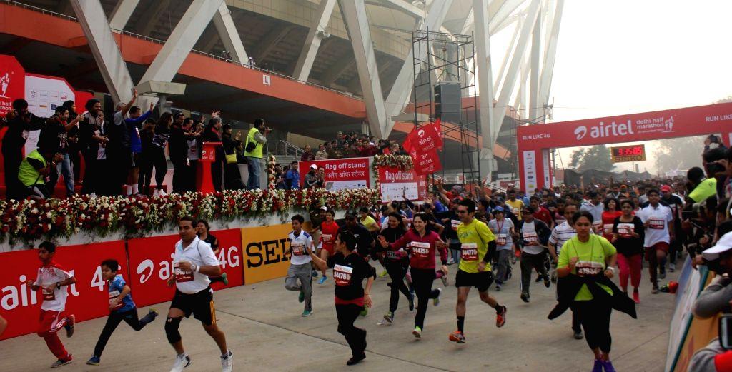 People participate in Airtel Delhi Half Marathon 2015 at India Gate in New Delhi, on Nov 29, 2015.