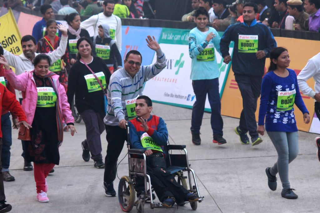 People participate in Airtel Delhi Half Marathon 2015 at India Gate in New Delhi, on Nov 29, 2015.