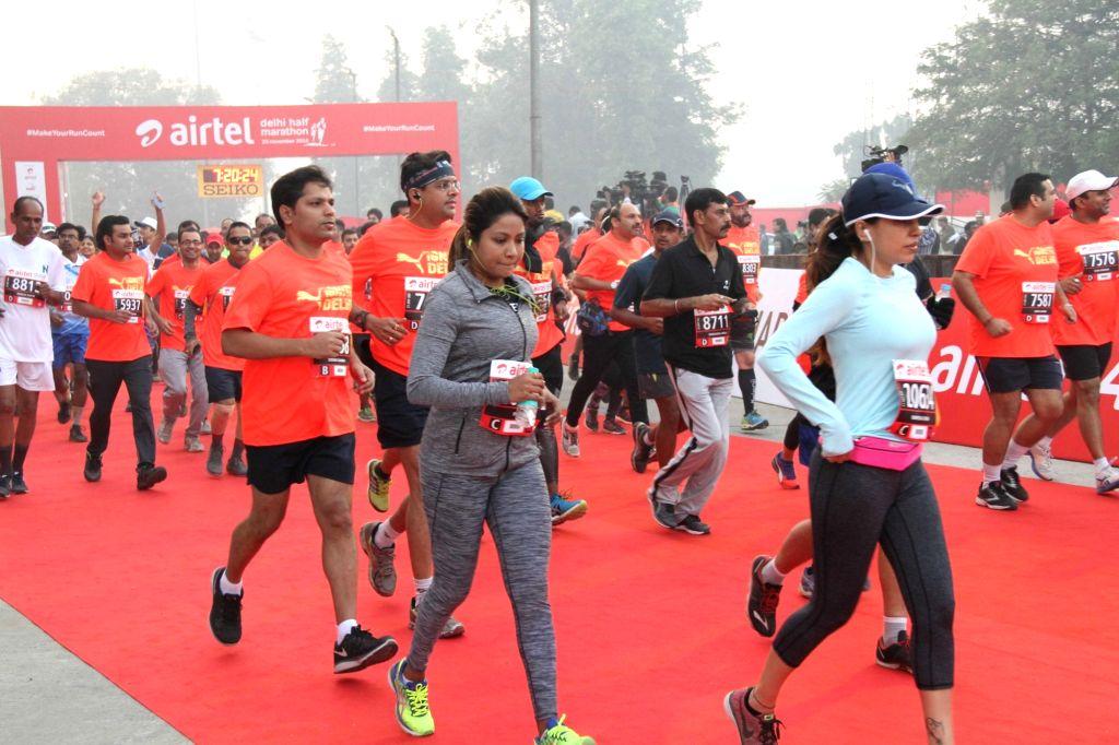 People participate in Airtel Delhi Half Marathon 2016 at Jawaharlal Nehru Stadium in New Delhi, on Nov 20, 2016.