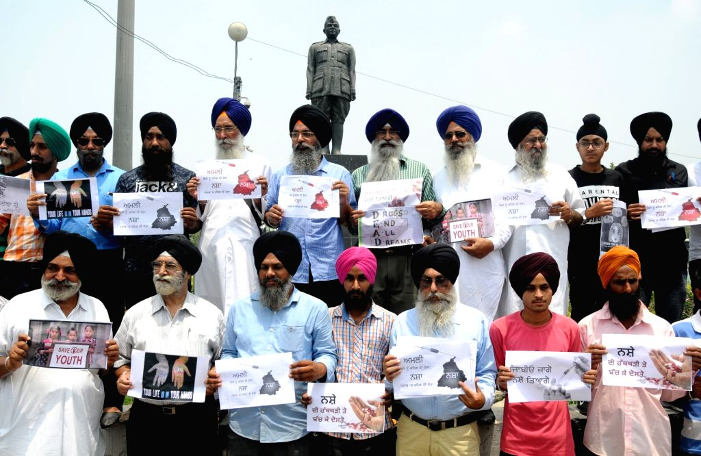 People participate in an anti-drug awareness programme in Amritsar, on July 6, 2018.