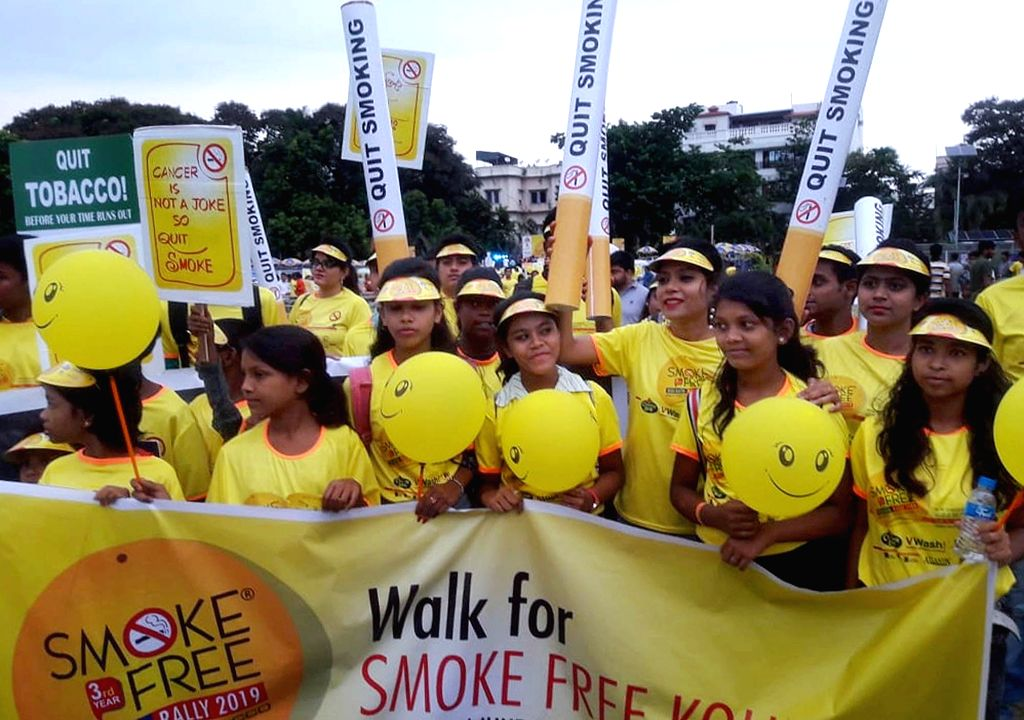 People participate in an awareness campaign against smoking, in Kolkata on June 2, 2019.