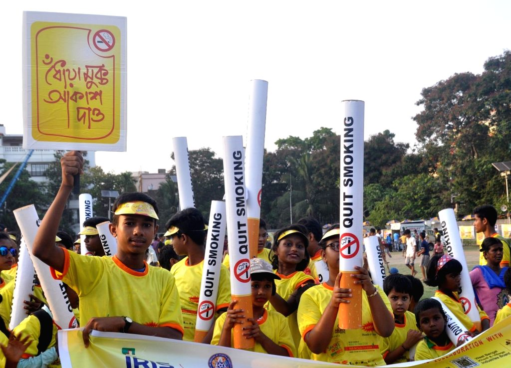 People participate in an awareness rally organsied ahead of World No Tobacco Day in Kolkata, on May 27, 2018.