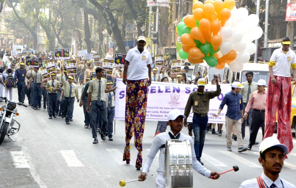 People participate in an awareness rally organised on the occasion of World AIDS Day in Kolkata, on Dec 1, 2018.
