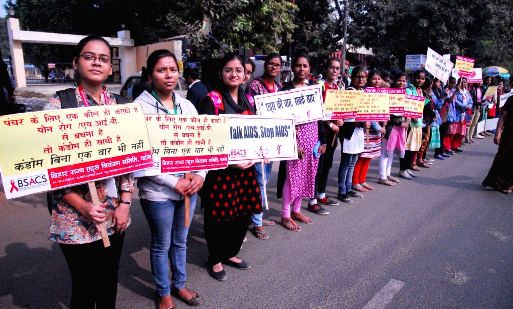 People participate in an awareness rally on the occasion of World AIDS Day in Patna, on Dec 1, 2018.