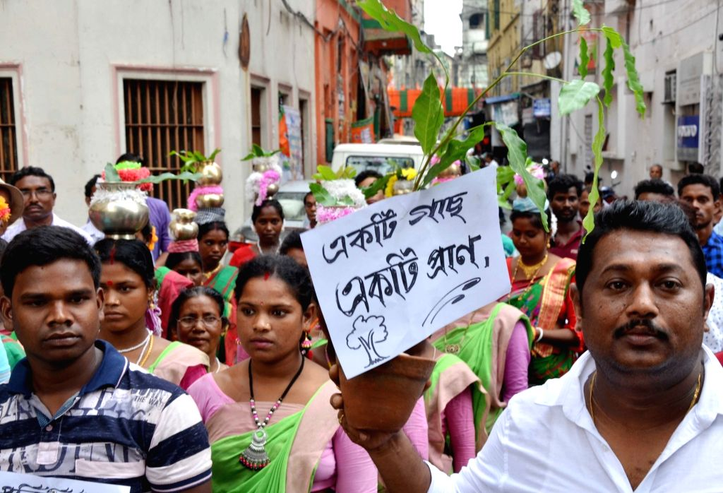 People participate in an awareness rally on World Environment Day in Kolkata on June Jun 5, 2019.