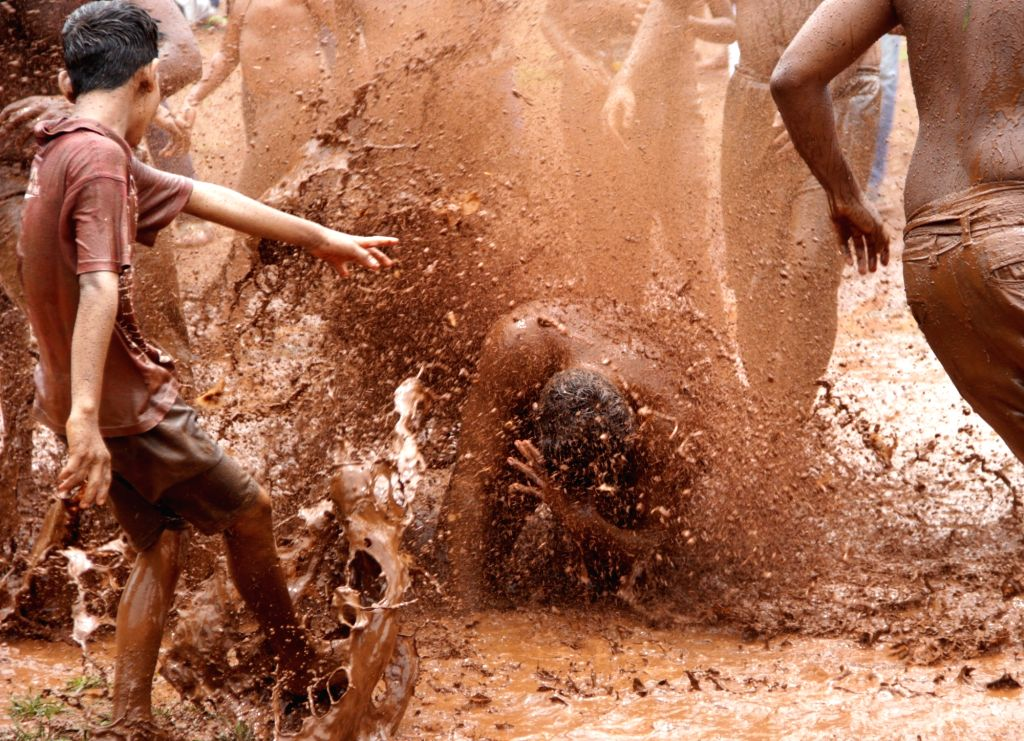 People participate in 'Chikhal Kalo' - mud play- near Devki Krishna Temple at Marcel some 18 kms from Panaji on July 6,2017.