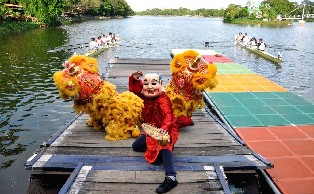 People participate in Dragon Boat Festival in Kolkata, on June 26, 2016.