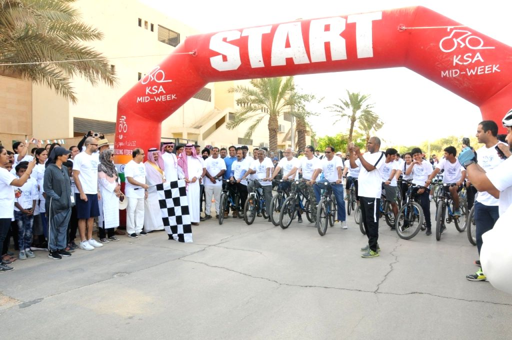 People participate in Gandhi cycle rally for peace in Riyadh.