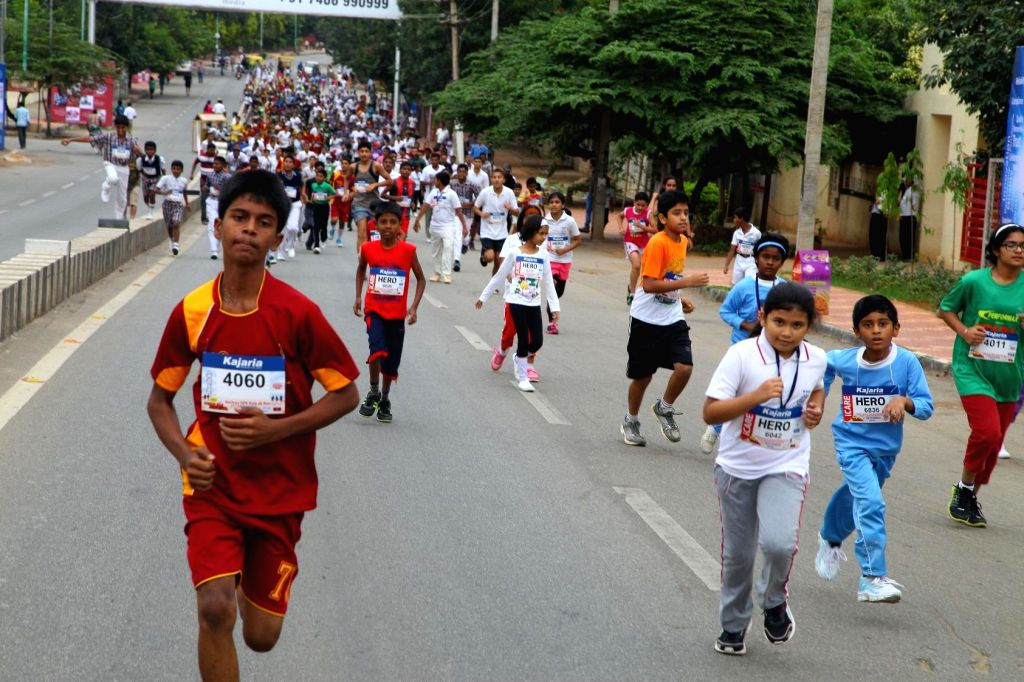 People participate in GFK Run organised in Bangalore on Sept 8, 2014.