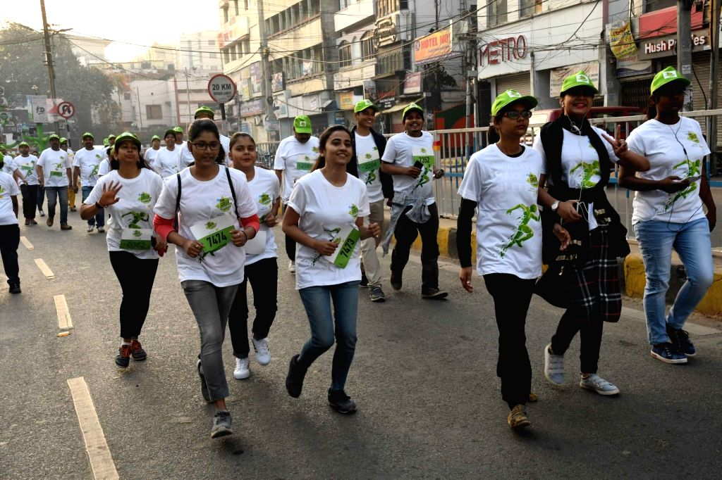 People participate in 'Green Marathon' organised to spread awareness about environment conservation, in Patna on March 10, 2019.
