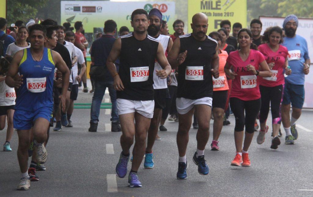 People participate in Gurugram Half Marathon on June 25, 2017.