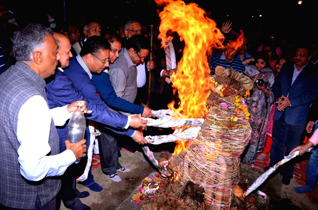 People participate in 'Holika Dahan' - burning of the devil on the eve Holi on March 13, 2017.