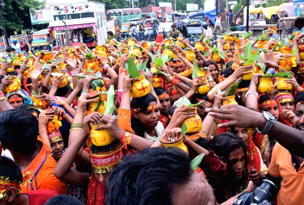 People participate in Kalash Yatra during the holy month of 'Shrawan' or 'Sawan' in Patna on Aug 7, 2019.