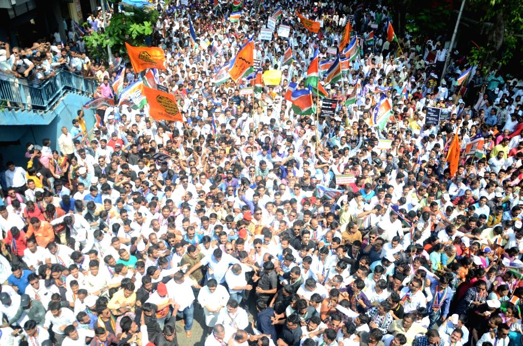 People participate in MNS' Santap rally against Elphinstone Road railway station stampede that killed 23 people and left over 30 injured, in Mumbai on Oct 5, 2017.