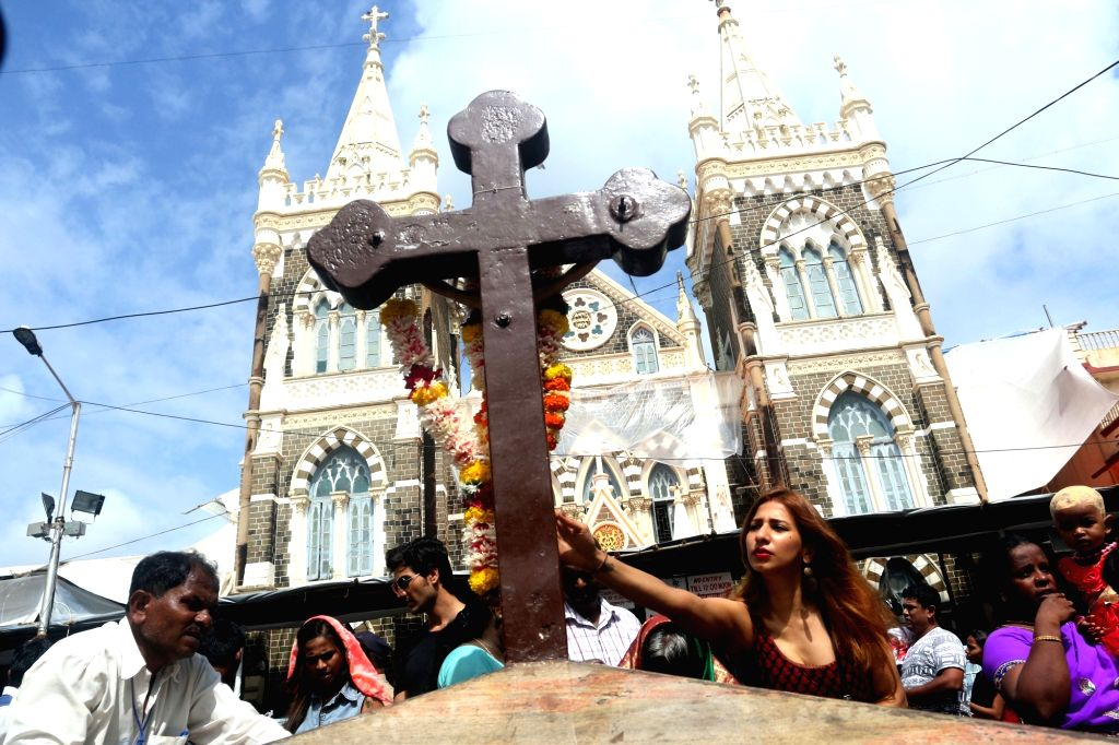 People participate in Mount Mary fair in Mumbai, on Sept 12, 2016.