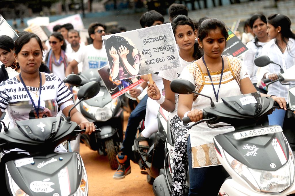 """People participate in """"Peace Bike Rally"""" from Malleshwaram to create awareness on child abuse and atrocities on women in Bangalore on July 30, 2014."""