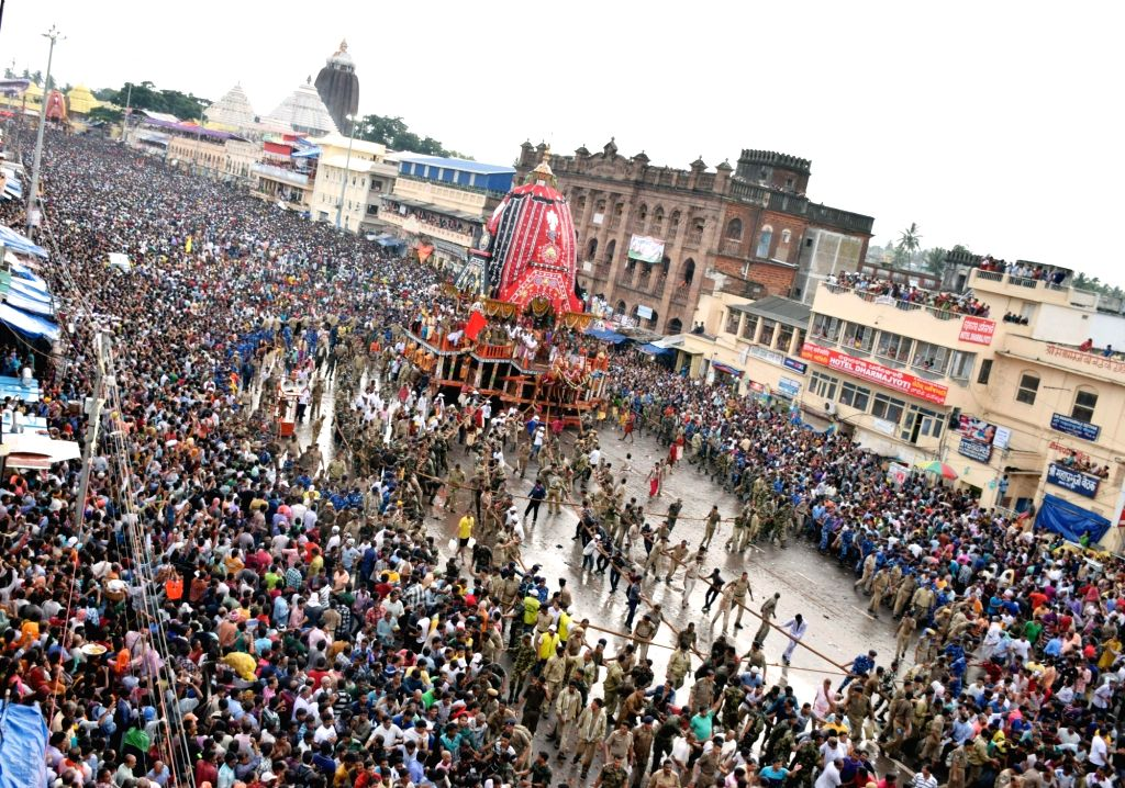 People participate in Rath Yatra in Puri of Odisha on July 6, 2016.