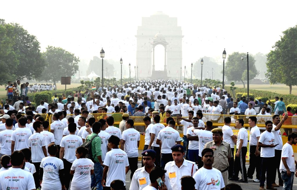 "People participate in ""Run for Unity"" on Rashtriya Ekta Diwas at National Stadium in New Delhi on Oct 31, 2016."