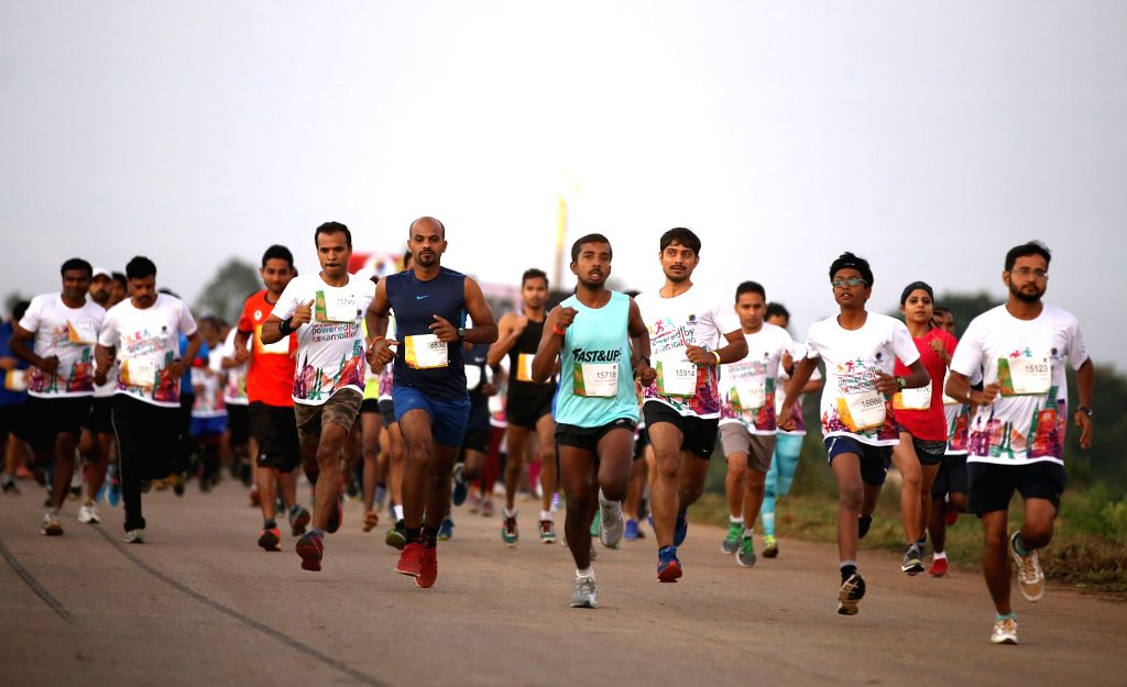 People participate in Spirit of Wipro Run 2016 in Bengaluru, on Sept 25, 2016.