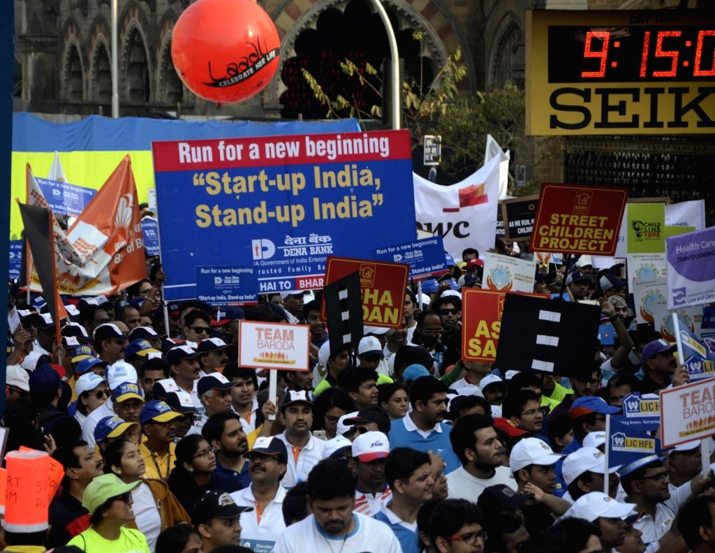 People participate in Standard Chartered Mumbai Marathon 2016 on Jan 17, 2016.