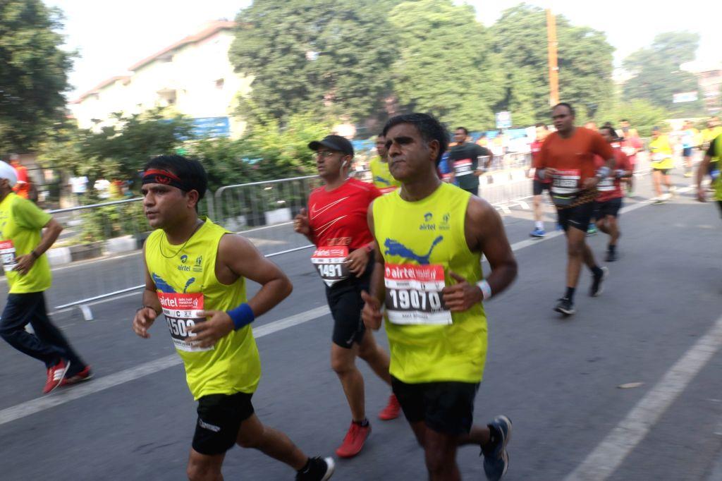 People participate in the Airtel Delhi Half Marathon on Oct 20, 2019.