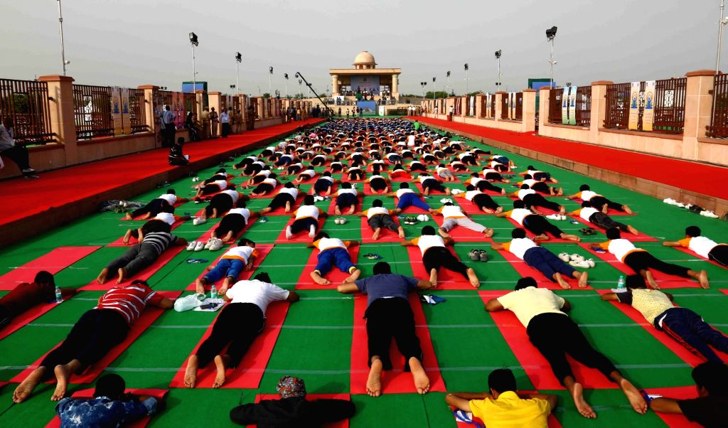 People participate in the full dress rehearsal ahead of the Prime Minister's event on the International Day of Yoga 2017 at Ramabai Ambedkar Maidan in Lucknow on June 19, 2017.