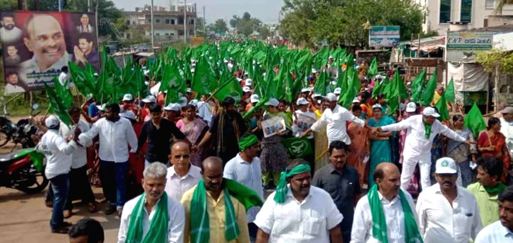 """People participate in the """"Save Amaravati Marathon Walk"""" organised by farmers to oppose the Andhra Pradesh Government's decision to have three capitals for the state; in ..."""