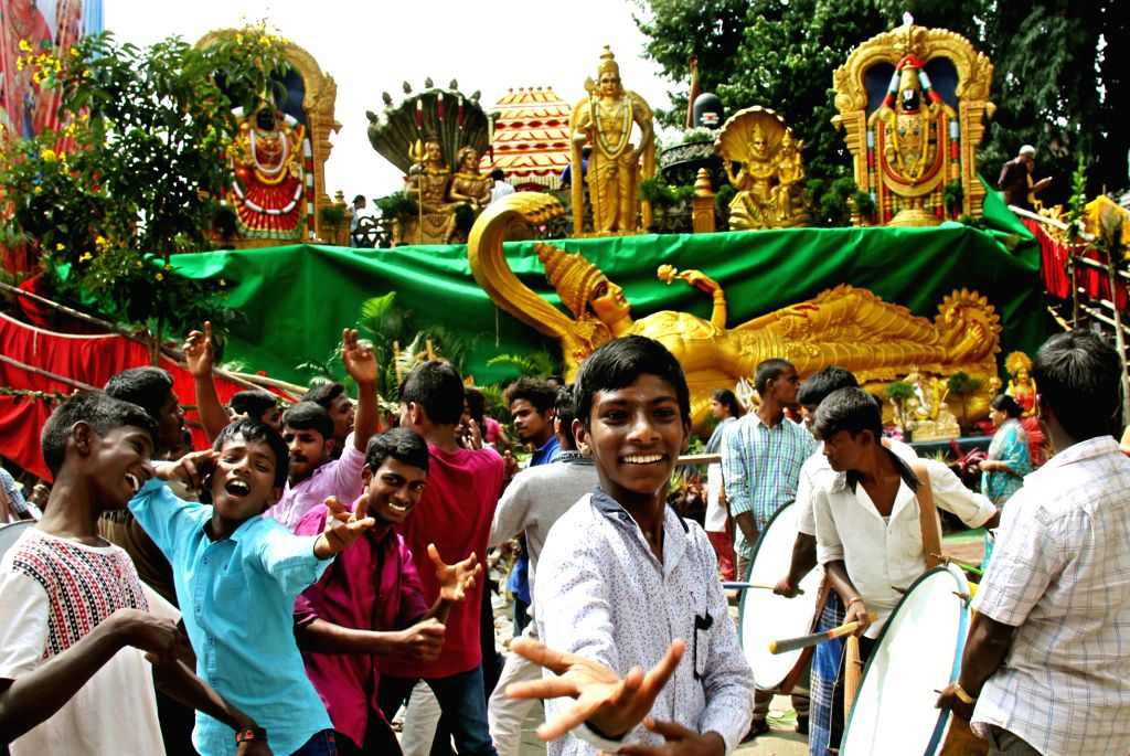 People participate in traditional Annual Car festival procession in Bengaluru, on Oct 23, 2016.