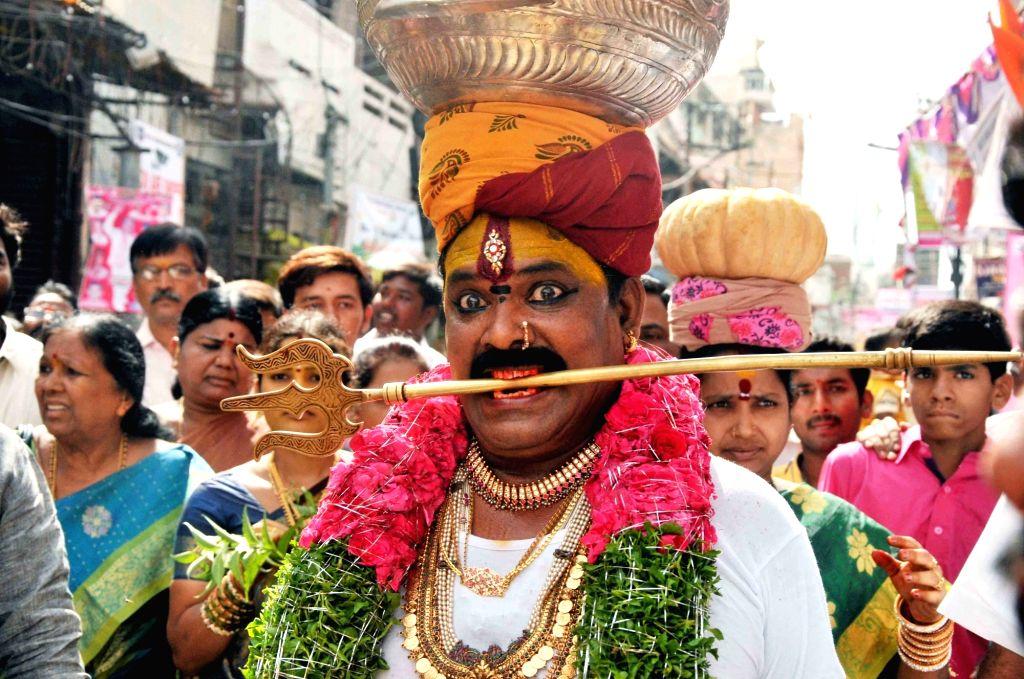 People participate in Ujjaini Mahankali Bonalu festival in Secunderabad, on July 9, 2017.