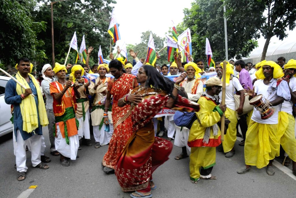 People participate in World Tribal Day celebrations in Patna on Aug 9, 2017.