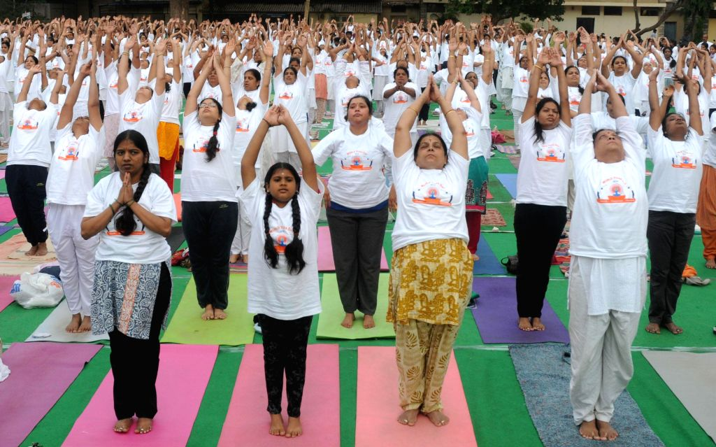 People participated in suryathon, mass suryanamaskara, on the occasion of World Yoga Day at BMS college of engineering, Basavanagudi, in Bangalore  on June 21, 2014.