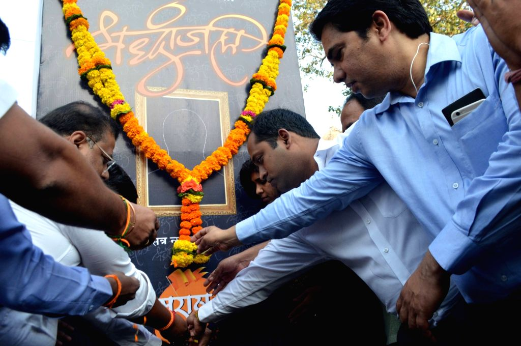 People pay homage to the victim in Kopardi rape case at Chhatrapati Shivaji Terminus in Mumbai on Nov 29, 2017.  A sessions court in Ahmednagar, Maharashtra, today awarded death sentence to ...