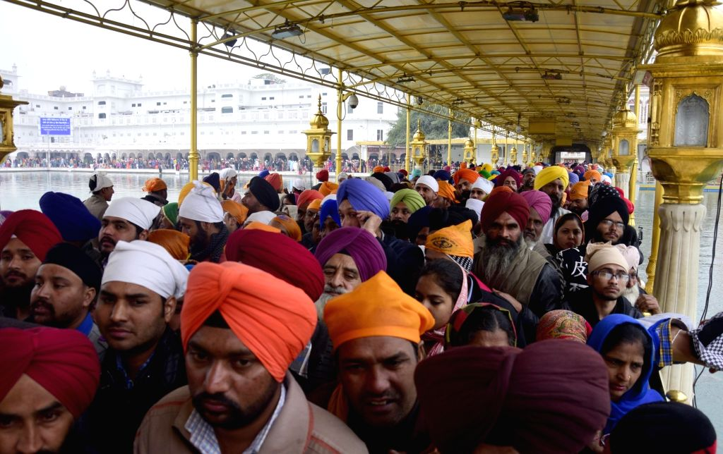 People pay obeisance at the Golden Temple on Makar Sankranti in Amritsar, on Jan 14, 2017.
