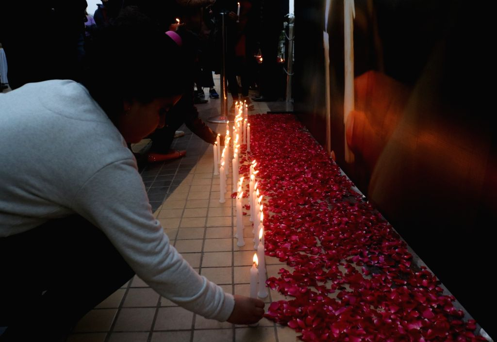 People pay tribute the 49 CRPF men killed in 14 Feb Pulwama militant attack, at a Delhi mall on Feb 16, 2019.