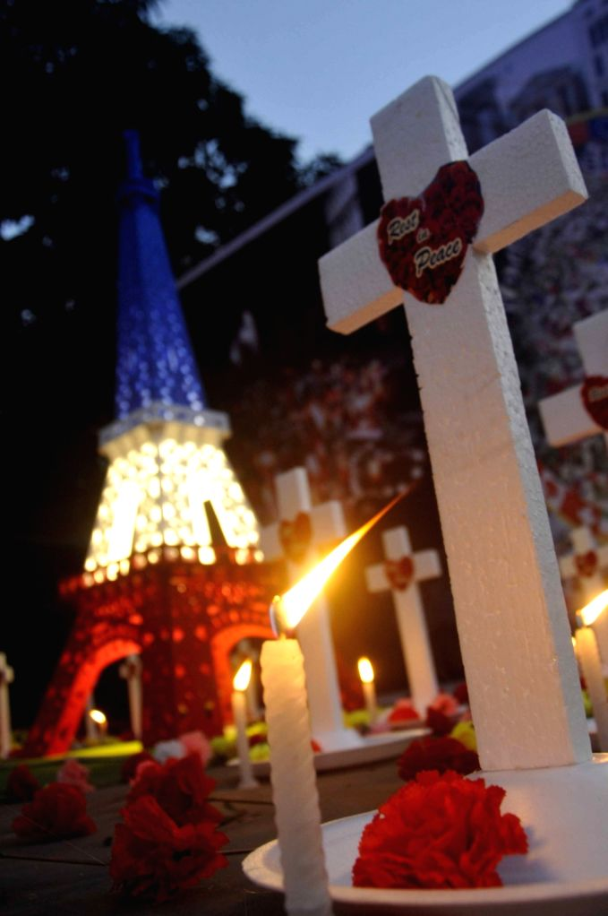 People pay tribute to Paris terror attack victims during a ceremony to commemorate the one year anniversary of the terrorist attacks in Pairs of France; in Kolkata on Nov 16, 2016.