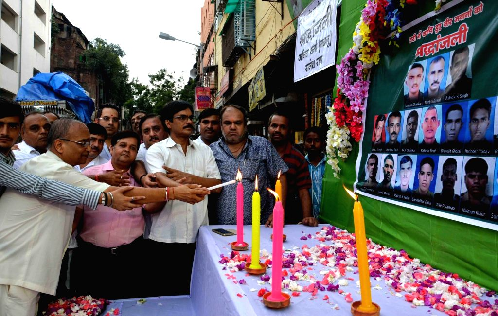 People pay tribute to Sept 18 Uri martyrs, in Kolkata on Sept 20, 2016.