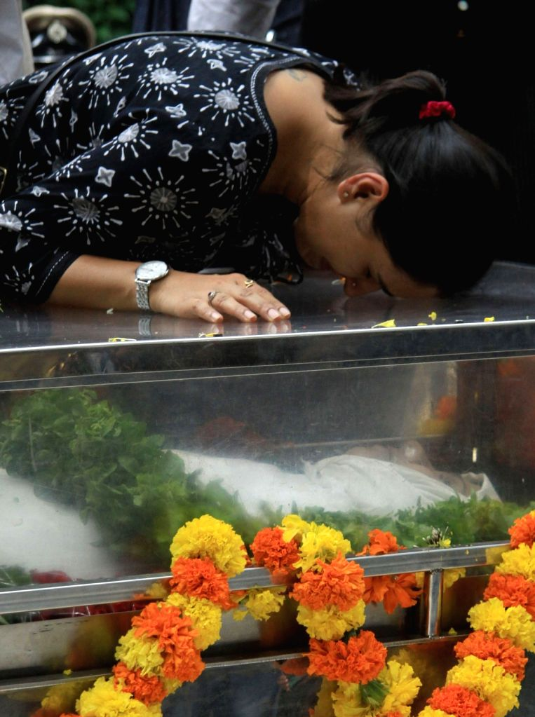"""People pay tributes during the public viewing of the mortal remains of Gauri Lankesh in Bengaluru on Sept 6, 2017. Editor of the weekly Kannada tabloid """"Lankesh Patrika"""", Lankesh ..."""