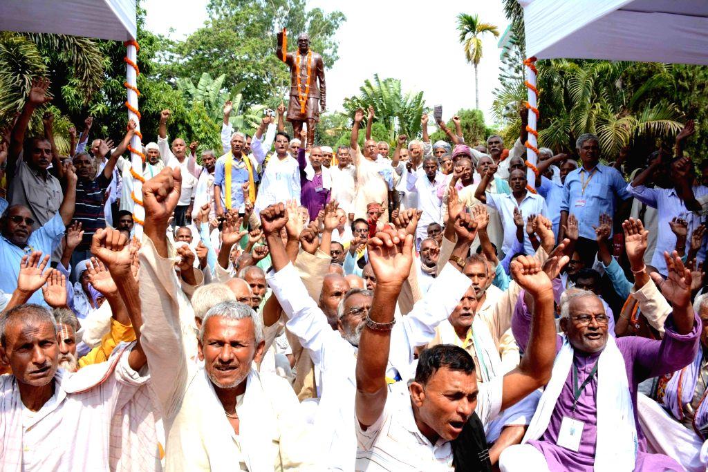 People pay tributes to Jayaprakash Narayan during Sampurna Kranti Diwas celebrations, in Patna on June 5, 2018.