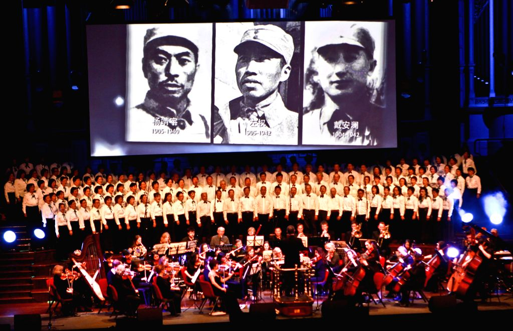 People perform a chorus during a concert held by overseas Chinese in Australia to mark the 70th anniversary of the victory in the Chinese People's War of Resistance ...