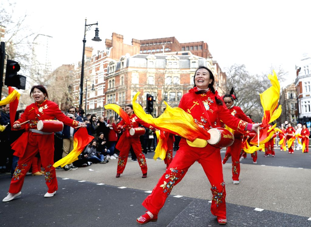 People perform Ansai waist-drum during a Chinese Lunar New Year parade in London, Britain, on Jan. 26, 2020.